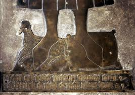 Detail from the brass of John Fortey in Northleach Church: his feet rest on a lamb and a wool-sack, his sources of wealth.