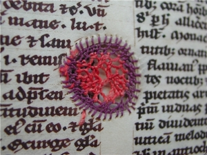 Medieval manuscript mended with embroidery. See http://www.ub.uu.se/en/Just-now/Projects/Completed-projects/A-medieval-book-mended-with-silk-thread/
